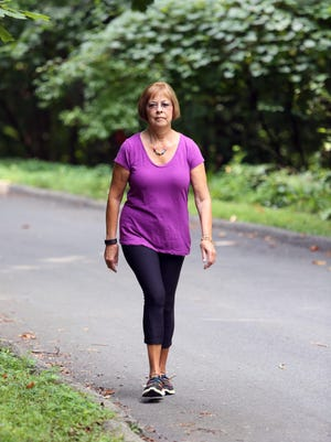 Ruth Barton, 72, of Mahopac walks in her neighborhood Aug. 25, 2015. She underwent a direct lateral fusion to ease chronic back and leg pain at Northern Westchester Hospital.