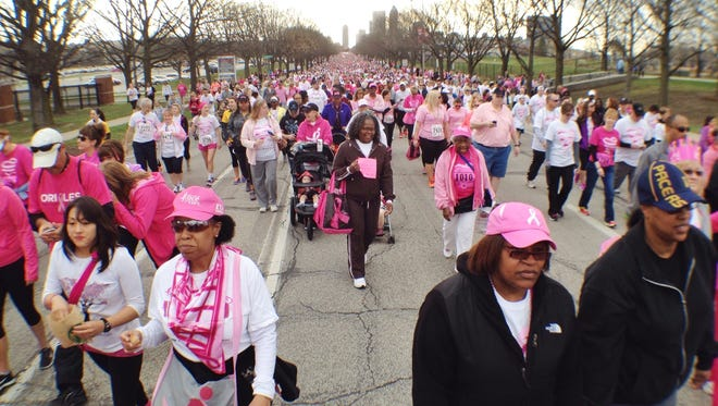 A sea of participants makes its way along New York Street during the start of today's Susan G. Komen Race for the Cure.