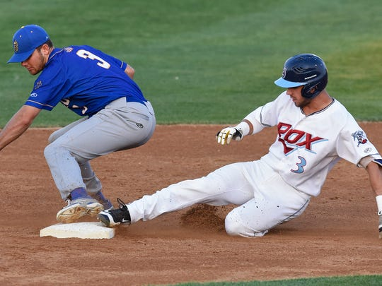 Rox baserunner Denis Karas beats the tag by Kyle Crowl of Waterloo during Wednesday's game at Joe Faber Field in St. Cloud.