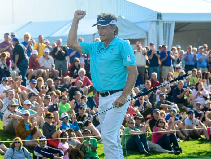 Bernard Langer raises his arm in the air after winning the 2014 Dick's Sporting Goods Open on Sunday at En-Joie Golf Course in Endicott.