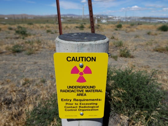A sign warns of radioactive material stored underground