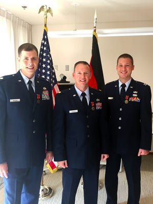 Maj. Ryan Murray, 341st Logistics Readiness Squadron commander at Malmstrom Air Force Base, was awarded the Bronze Foreign Duty Medal of the Federal Armed Forces on behalf of the Federal Republic of Germany, Jan. 6, 2015. Murray, center, received the medal along with his team members, Maj. Joseph Wilson, left, and Capt. Eric Birdsong, right, for work in a joint coalition task force in Kabul, to advise national level logistics for the Afghanistan Army and Police.
