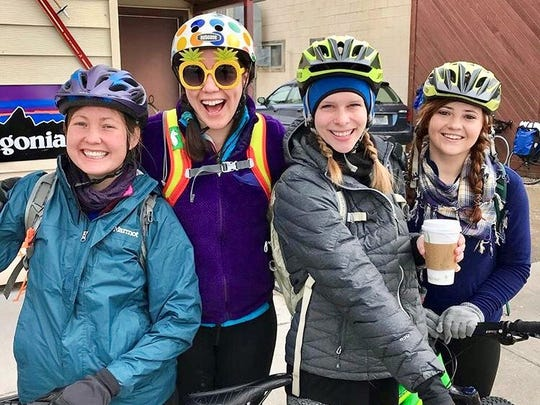 From the left: Abigail Lichliter, Sadie Russell, Cayce Richards and Tribune outdoors reporter Sarah Dettmer get ready to head out on a 60-mile ride through Yellowstone National Park on April 14, 2018.