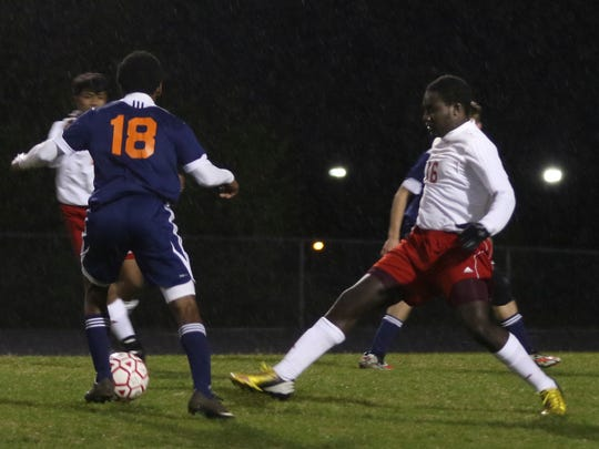 Rossview's Alain Brown (16) gets in front of Dickson County's Darius Haynes (18) during their game on Thursday. Dickson County won the game 2-0.