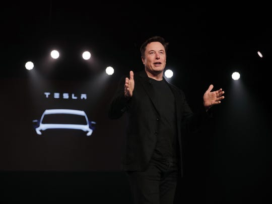 Tesla CEO Elon Musk appears poised to transform the company's electric cars into driverless vehicles in a risky bid to realize a bold vision that he has been floating for years.