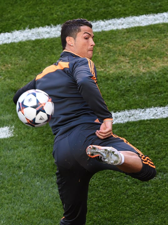 Real's Cristiano Ronaldo controls the ball,  during a training session ahead of Saturday's Champions League final soccer match between Real Madrid and Atletico Madrid, in Luz stadium in Lisbon, Portugal, Friday, May 23, 2014. (AP Photo/Paulo Duarte)
