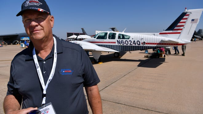 """Jim Kaiser stands before an airplane May 12 stenciled with the names of every active duty U.S. military member who lost their lives since Sept. 11, 2001. The """"Snowball Express: We Remember Tour,"""" of which Kaiser is one of the pilots, will be at the Breckenridge Airshow this weekend."""