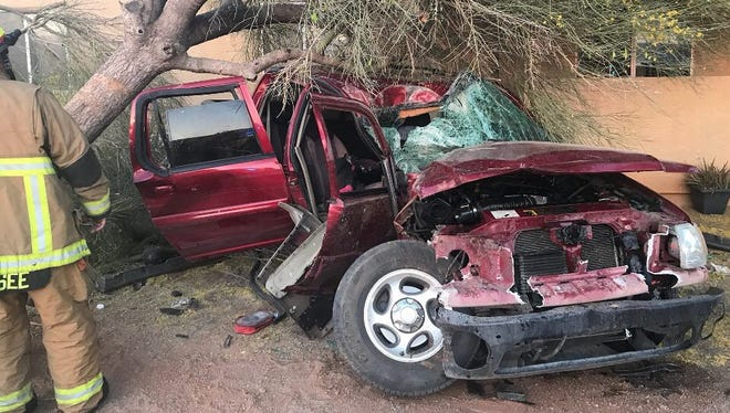 A midsize four-door truck hit a tree; emergency crews responded to the scene on April 19, 2018.
