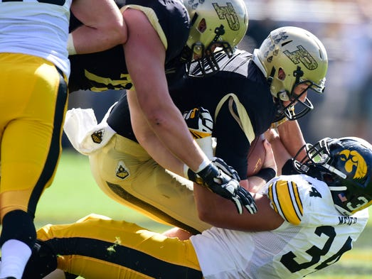 Sep 27, 2014; West Lafayette, IN, USA; Purdue Boilermakers quarterback Danny Etling (5) is sacked by  Iowa Hawkeyes defensive end Nate Meier (34) during the first quarter at Ross Ade Stadium. Mandatory Credit: Marc Lebryk-USA TODAY Sports
