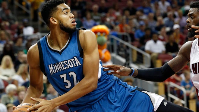 Minnesota's Karl-Anthony Towns saves the ball from going out of bounds. Oct. 15, 2016