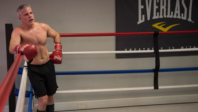 Evansville firefighter takes a break on the ropes during a Hoses team practice at the Guns and Hoses Gym in Old Vanderburgh County Courthouse on Friday, March 30, 2018. The Guns and Hoses event pits law enforcement officers against firefighters in night of charity boxing matches on April 7.