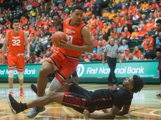 UNLV forward Tervell Beck falls to the court as CSU
