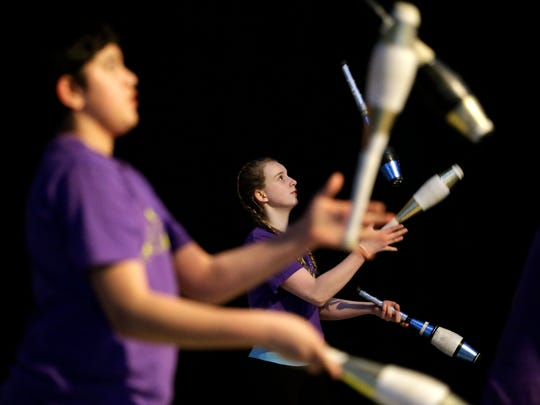 Gabbie Cain, back, and Eric Marrero perform a juggling act during a show by the Trenton Circus Squad.