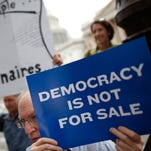 Supporters of campaign finance reform rally outside the U.S. Capitol on Sept. 8 in Washington, D.C..