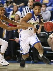 Delaware guard Anthony Mosley gets past Drexel defender