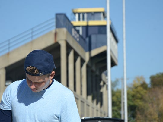 Battle Creek Central senior Daniel Goins, 17, reviews his University of Michigan-themed parking spot Sunday near the high school in Battle Creek.