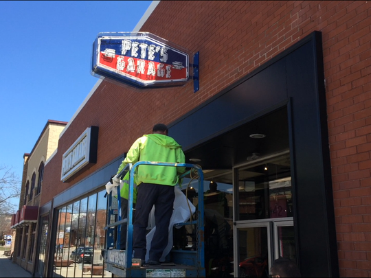 Sign crews mounted two new neon signs on the exterior of the new home of Pete's Garage, 142 N. Broadway.
