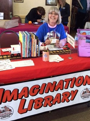 Imagination Library volunteer Theresa Murphy enjoys signing up children for the program which mails out free books to young readers.