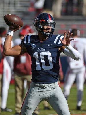 Mississippi quarterback Jordan Ta'amu (10) warms up before an NCAA college football game between Mississippi and Arkansas in Oxford, Miss., Saturday, Oct. 28, 2017. (AP Photo/Thomas Graning)
