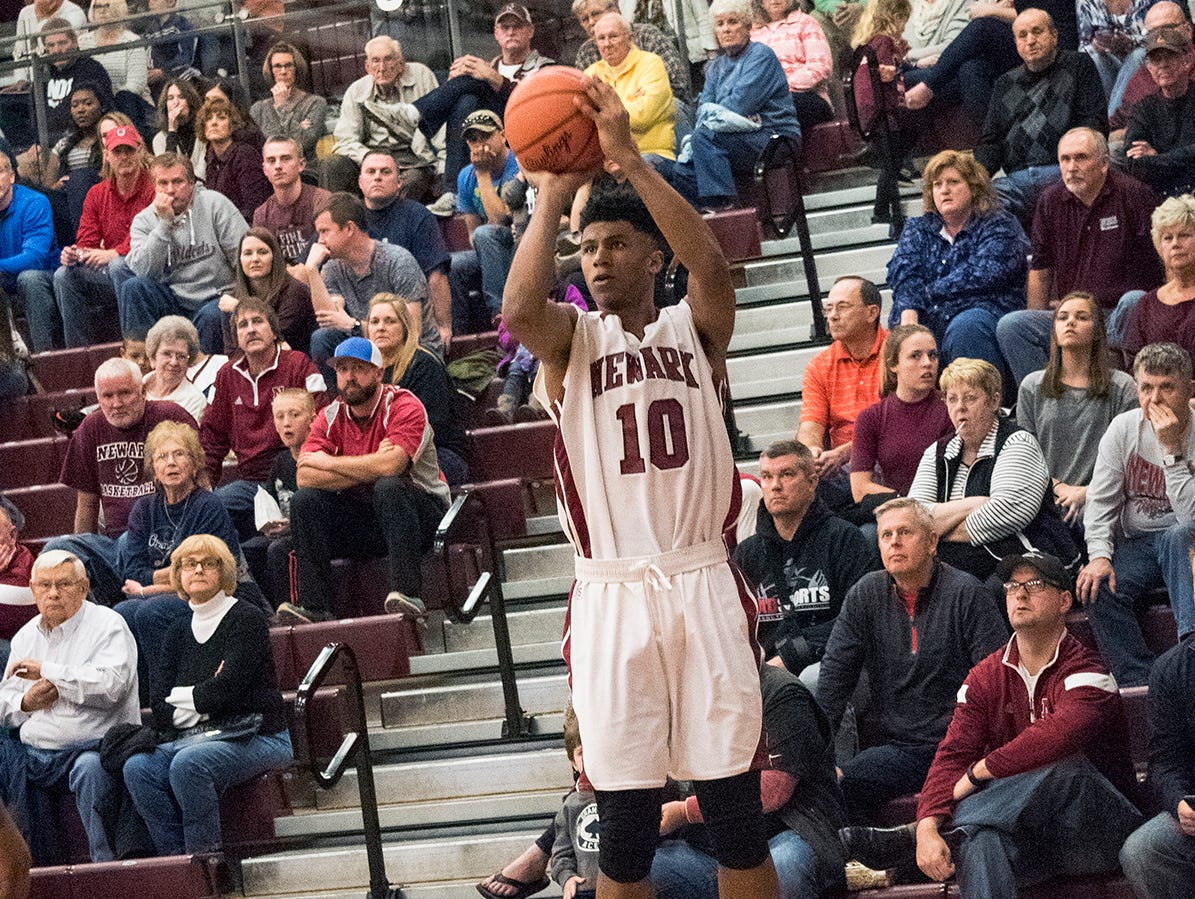 Newark junior Bradley Duling Jr. shoots a 3 pointer during the 2nd half of action Friday night at Jim Allen Gymnasium.