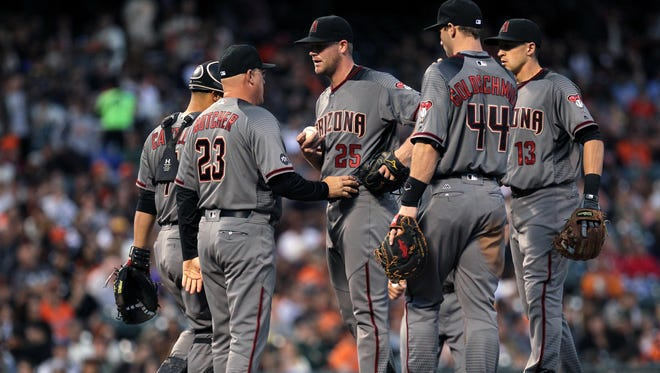 Arizona Diamondbacks starting pitcher Archie Bradley (25) gets a visit on the mound by pitching coach Mike Butcher {23) in the first inning of the MLB baseball game in the San Francisco Giants at AT&T Park.