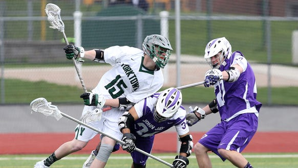 From left, Yorktown's Kyle Casey (15) tries to get