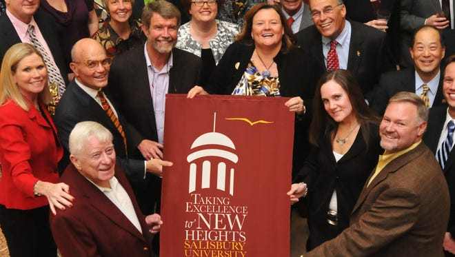 Dr. Norman Crawford, left, president of Salisbury University from 1970 to 1980, and other supporters celebrated the culmination of SU's 2012 capital campaign. Crawford died Thursday, May 12, 2016.