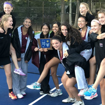 Ridgewood's girls tennis team celebrating after winning