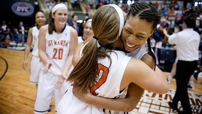 Ashia Jones (right), shown after the 2014 OVC championship game, has been dismissed from the UT Martin women's basketball team.