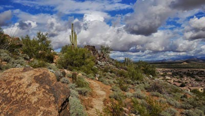 Desert clouds hover above the East Wing Mountain trails in north Peoria.