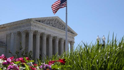 An American flag flies over the U.S. Supreme Court June 29, 2015 in Washington, DC.