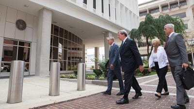 Former Wilmington Trust President Robert Harra Jr. (second from left) arrives at the federal courthouse in Wilmington for his arraignment accompanied by his wife, Linda, and lawyers Michael Kelly (right) and Andrew Lawler in this file photo.