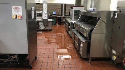 Burst pipes in a Chase Field air-conditioning system flood the Paradise Valley Burger concession stand on June 25, 2017. Photo from Arizona Diamondbacks court filing.