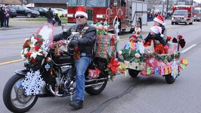 Gary Fox from the American Legion Post 396 in Garden City rides his beautifully decorated Honda at the 55th annual Santaland Parade in 2015.