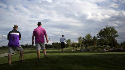 Men's league golfers tee off on the first hole Thursday at the Pelican Lakes Golf Country Club in Windsor.