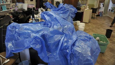 Tarps will be distributed at several locations Saturday for those in need.