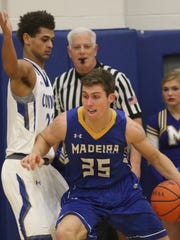 Madeira's Jack Cravaack drives to the basket against