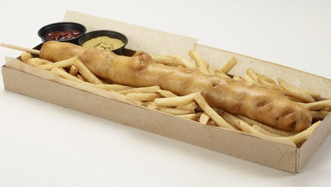 The D-Bat Dog is an 18-inch, fried corn dog with cheddar cheese, jalapenos and bacon that comes with a side of fries. It will be available this season at Chase Field in Phoenix for $25.