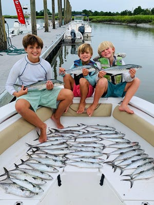 Pictured from from left to right are Win Woods, James Woods, and Harrison Woods of Savannah. They caught these Spanish mackerel at the nearshore reefs off of Savannah on Aug. 22 while fishing with their dad.