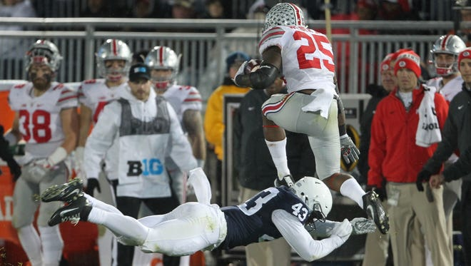 Linebacker Manny Bowen, seen here making a tackle against Ohio State last season, has been dismissed from the Penn State football team for a rules violation. AP FILE PHOTO