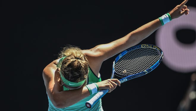 Victoria Azarenka of Belarus dabs after defeating Barbora Strycova of the Czech Republic to advance to the Australian Open quarterfinals.