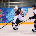 Feb 13, 2014; Sochi, RUSSIA; USA forward Patrick Kane (88) carries the puck past Slovakia defenseman Martin Marincin (52) in a men's ice hockey preliminary round game during the Sochi 2014 Olympic Winter Games at Shayba Arena. Mandatory Credit: Richard Mackson-USA TODAY Sports