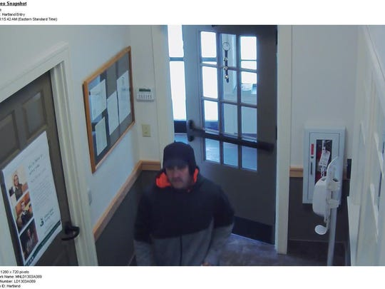 Cameras show a robbery suspect at the Mascoma Savings Bank in Hartland.
