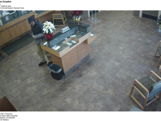 Cameras show a robbery suspect at the Mascoma Savings