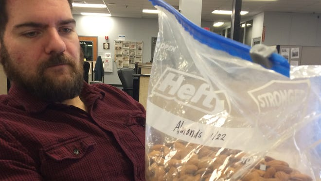 This is Courier-Post digital producer Matt Flowers. And this is his almond stash.