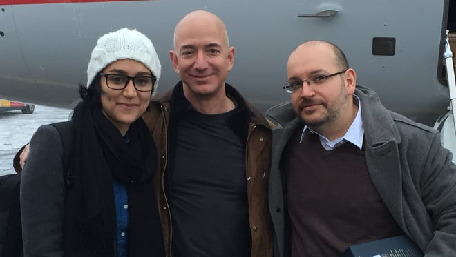Jason Rezaian, right, and his wife, Yeganeh Salehi, with Washington Post owner Jeff Bezos in Saarbruecken, Germany, before taking off for a return journey to the USA on Jan. 22, 2016.