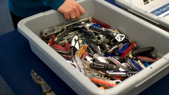 Lisa Farbstein shows a collection of blades either confiscated or left behind at Greater Rochester International Airport.