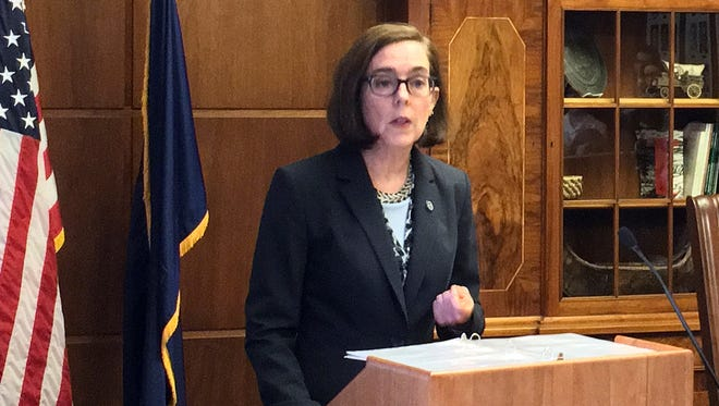 In this April 27, 2017, file photo, Oregon Gov. Kate Brown speaks in the Capitol ceremonial office in Salem.