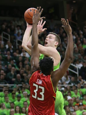 Michigan State's Matt Costello scores against Maryland's Diamond Stone during the second half Saturday  at the Breslin Center.