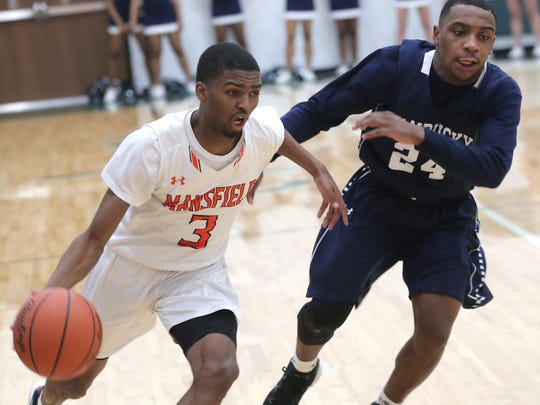 Mansfield Senior's Byron Patrick Jr. dribbles the ball down the court during a sectional game against Sandusky at Madison on Tuesday.